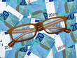 reading glasses on twenty euro background