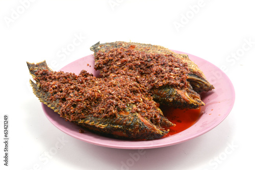 Fried chilli paste sauce with fish on white background