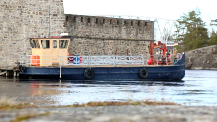 Boat docked at a medieval castle