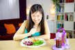 Chinese american girl ready to start diet with salad