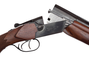 Opened double-barrelled hunting gun close-up isolated on white