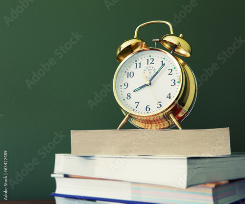clock on books
