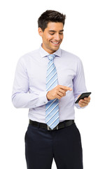 Smiling Businessman Reading Text Message On Smart Phone