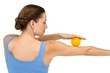 Rear view of a young woman holding stress ball on arm