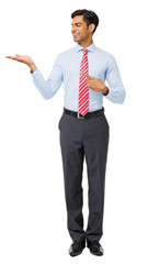 Young Businessman Pointing At Invisible Product