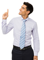 Businessman Smiling While Pointing Upwards
