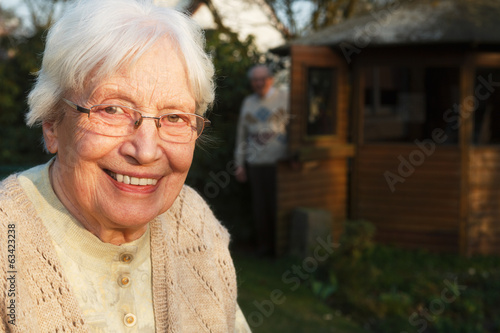 Elderly woman with walking frame in the garden