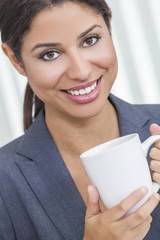 Woman Drinking Tea or Coffee