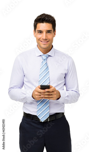 Confident Businessman Holding Smart Phone