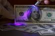 Dollar bill in uv light, fraud check