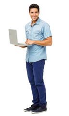 Portrait Of Confident Young Man Holding Laptop