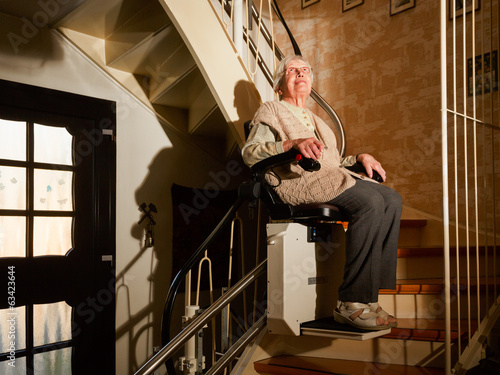 elderly woman using the stairlift