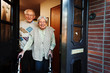 Leinwanddruck Bild - elderly couple opening the front door