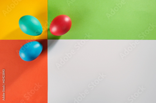 Colorful Easter eggs over creative editable background.