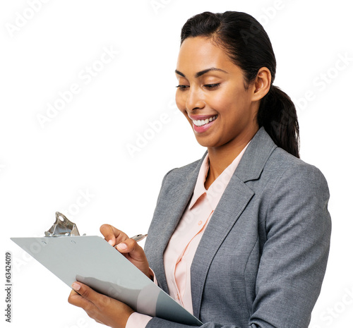 Businesswoman Writing On Clipboard