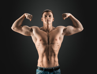 bodybuilder showing muscles in the arms