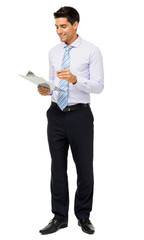 Businessman Reading Notes On Clipboard