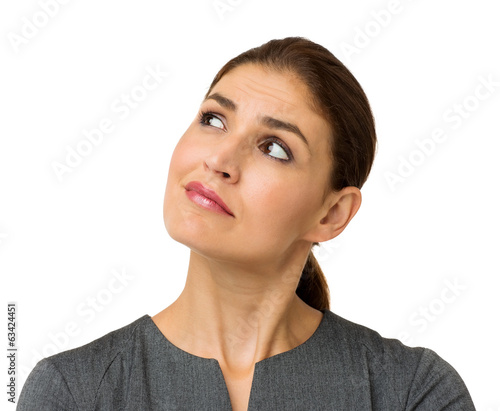 Confused Businesswoman Looking At Copy Space