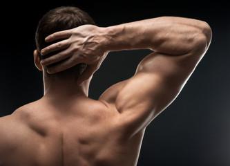 bodybuilder hand in the dark