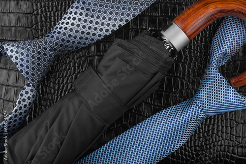 Two neckties  and  wallet   lying on the skin