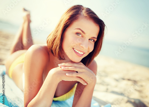 girl sunbathing on the beach
