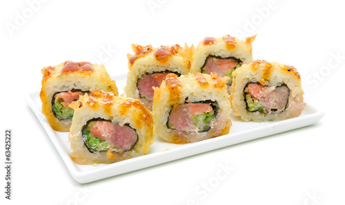 Japanese cuisine - hot rolls on a plate on white background