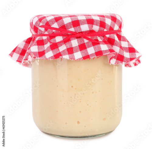 Horseradish condiment sauce in glass jar