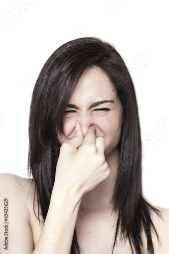 Girl smelling a bad odor