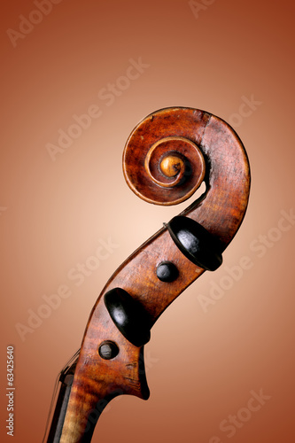 Violin peg box and scroll on orange background