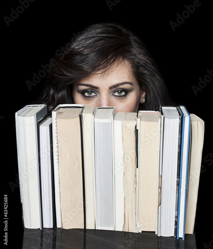 Girl hiding behind book shelf