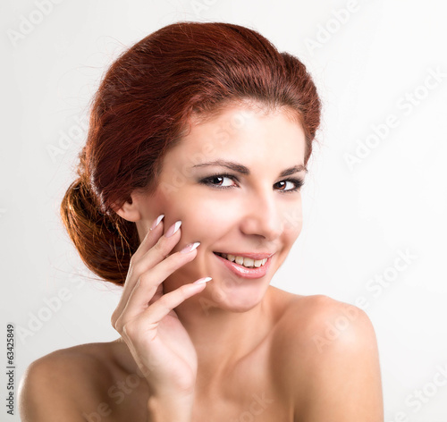 Beauty Portrait. Beautiful Spa Woman Touching her Face.