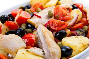 Mackerels with potatoes,tomatoes,capers and olives