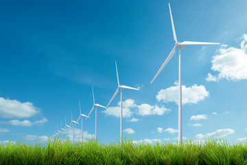 wind turbine with grass and blue sky