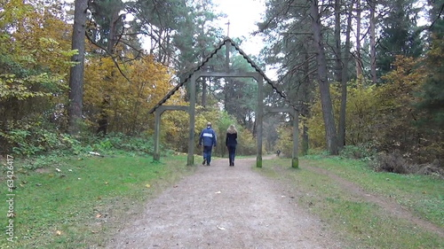 tourists go wide forest  path reaches wooden ark