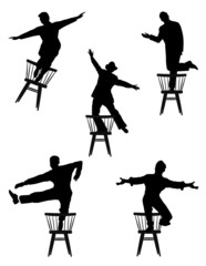men dancing on chairs