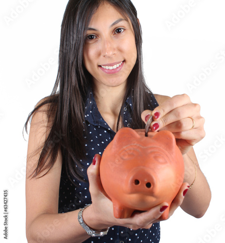Beautiful girl with a piggybank