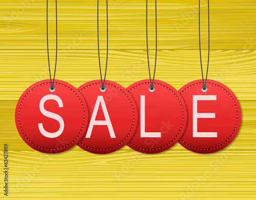 Sale tag with wooden background