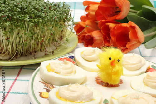 Halves of eggs with mayonnaise and Easter decoration