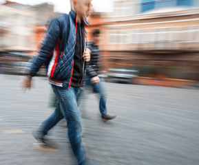 Group of young people hurrying about their business