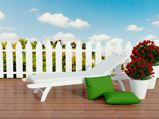 White sunlounger and roses.