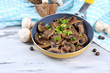 Delicious fried mushrooms in pan on table close-up