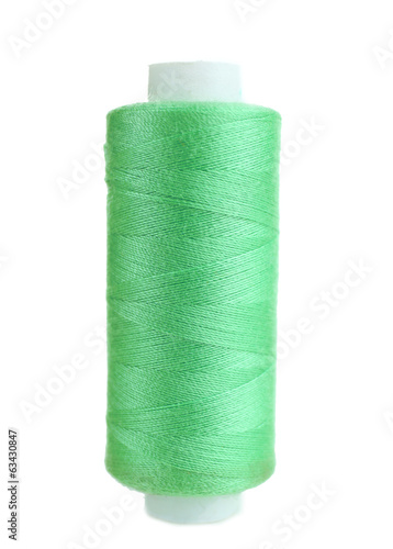 Colored spool of thread isolated on white