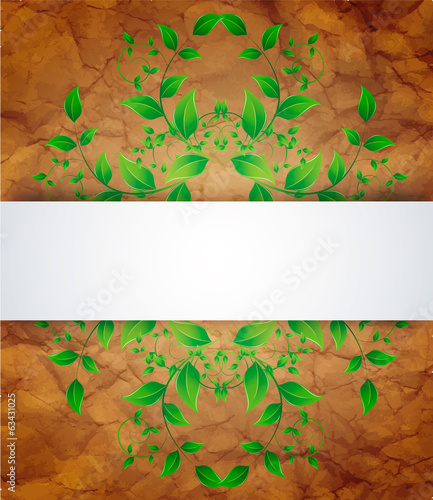 green leaves and crumpled paper