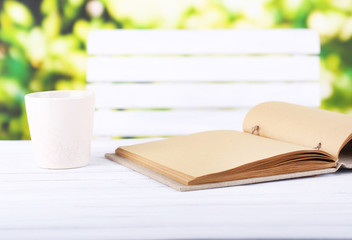 Empty notebook and cup of drink