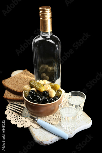 Composition with bottle  of vodka, and marinated  vegetables,