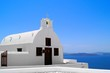 Tiny white church with blue sky, Oia, Santorini, Greece