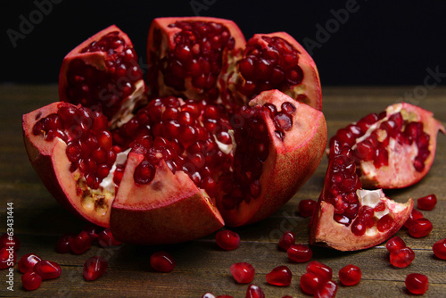 Ripe pomegranate on table close-up