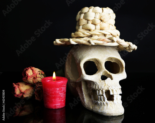 Composition with skull in hat,  candle and dried rose isolated
