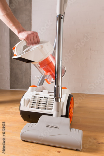 cleaning home with vacuum cleaner