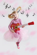 Girl with guitar on music notes background